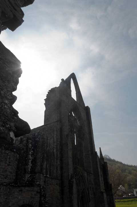 Photo of an abbey showing the sun shining through