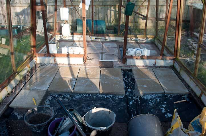 Mid way through laying of the paving within the greenhouse