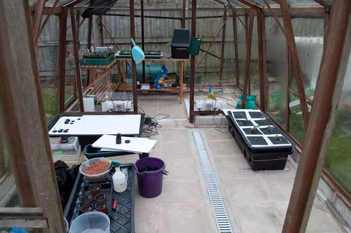 The finished greenhouse floor after paving has been laid and drainage put in
