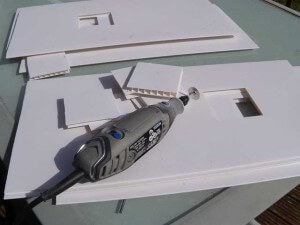 Cutting the holes out of the cladding with the Dremel